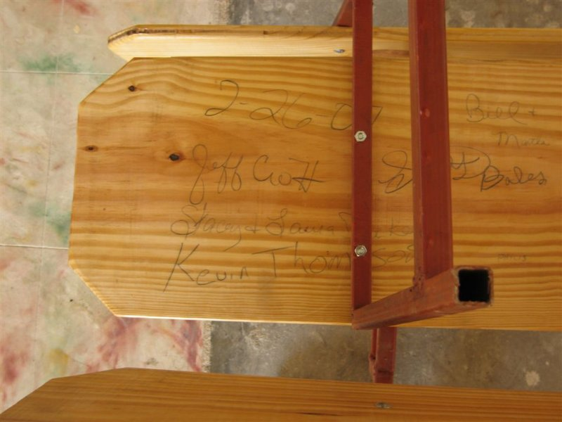 we signed the bottom of a pew before putting it together
