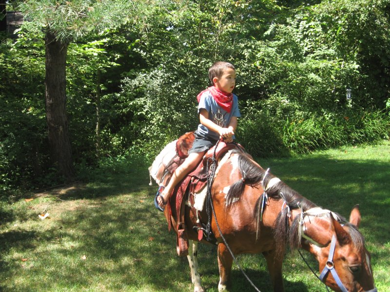Kyle going on a Pony Ride