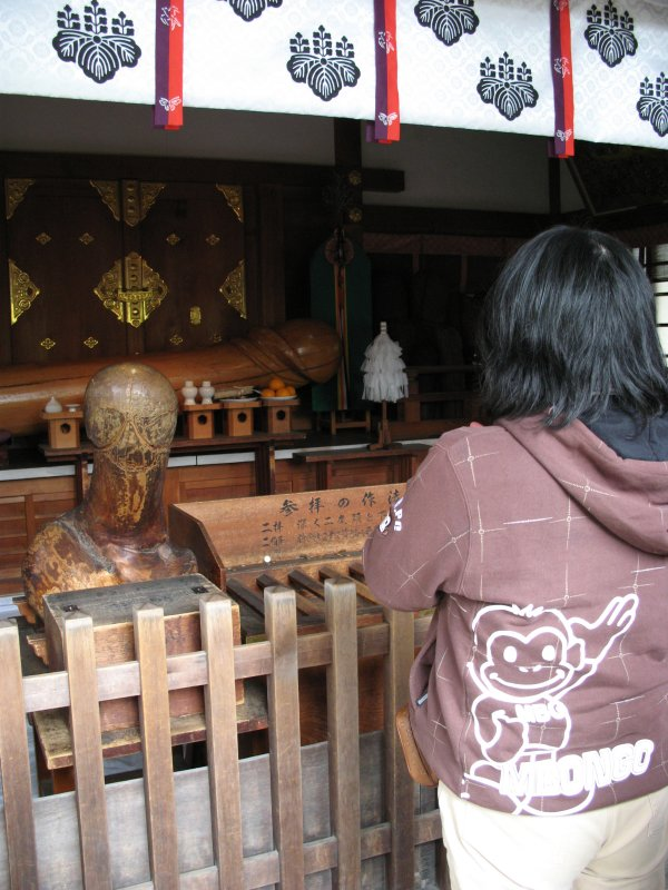 Praying at the smaller shrine