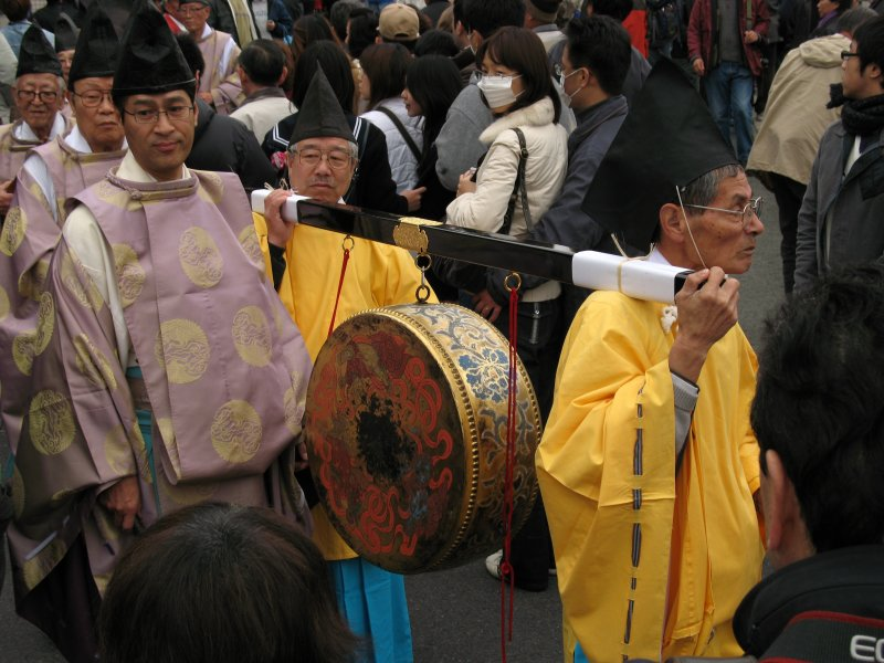 Carrying a ceremonial drum
