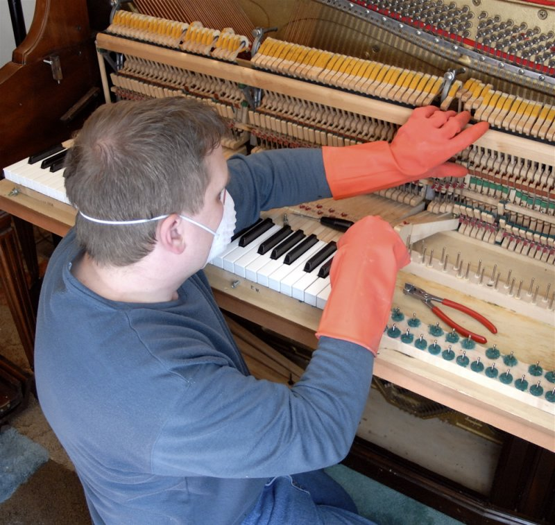 Lawrence Sudweeks of Pocatellos Piano Gallery repairing our piano _DSC0112