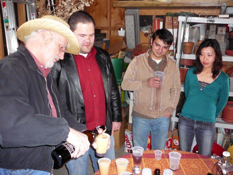 Trimmer Professor Ken pouring home brewed beer P1010280.JPG