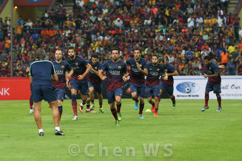 Barcelona players warm up