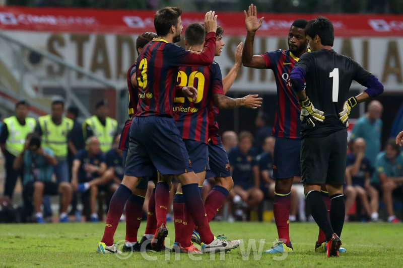 Barcelona celebrates their third goal