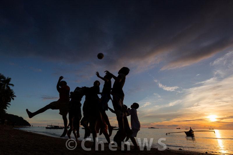 Kids playing beach soccer on Nirwana Beach