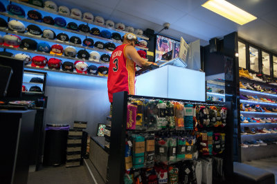 DJ in a sports shop at Queen Street Mall.