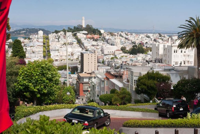 Lombard Street With Coit Tower In Distance