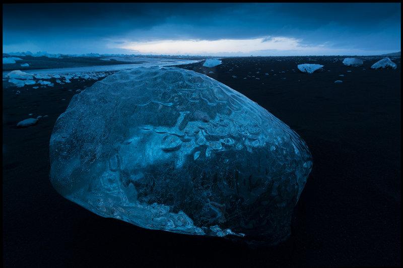 Magnificent piece of ice on the lava beach near Jökulsarlon