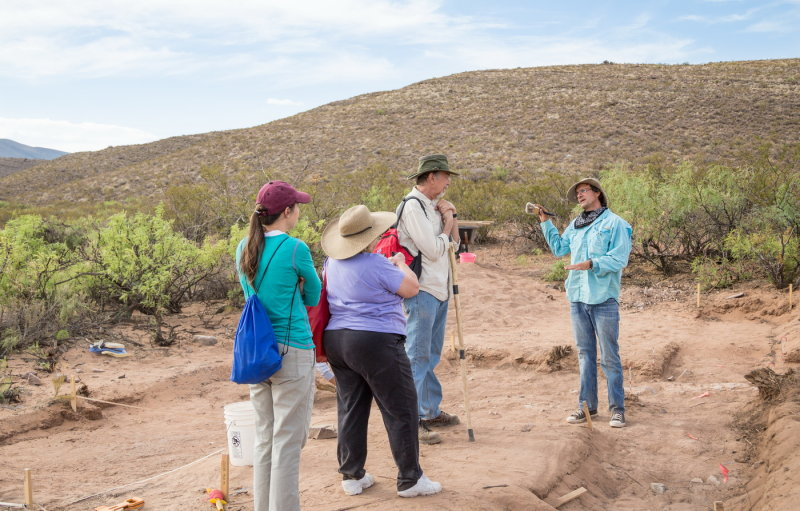 Dr. Bill Walker explains the site to visting anthropologists Drs. Mary Alice Scott, Miriam Chaiken, and Warren DeBoer