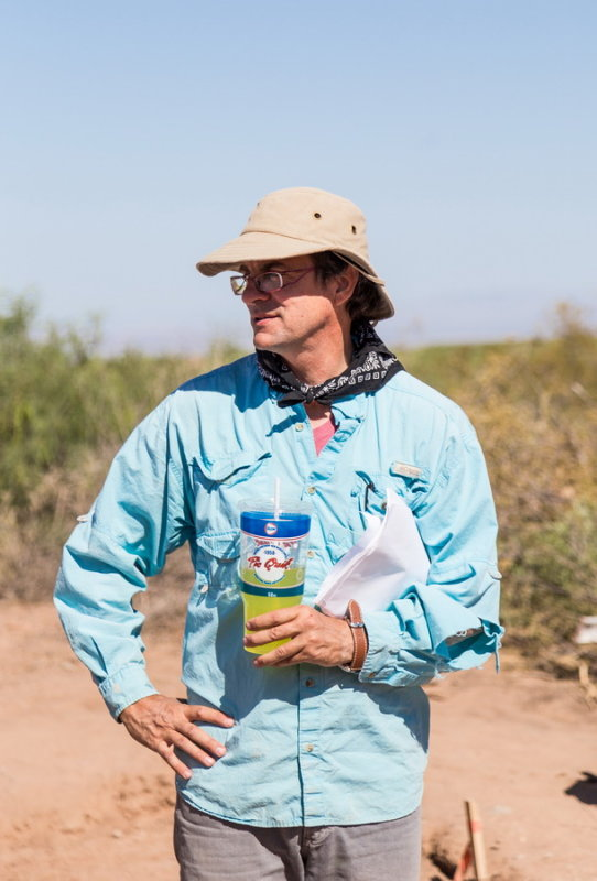 Dr. Bill Walker shows students how to remain fully hydrated in the 100+ heat