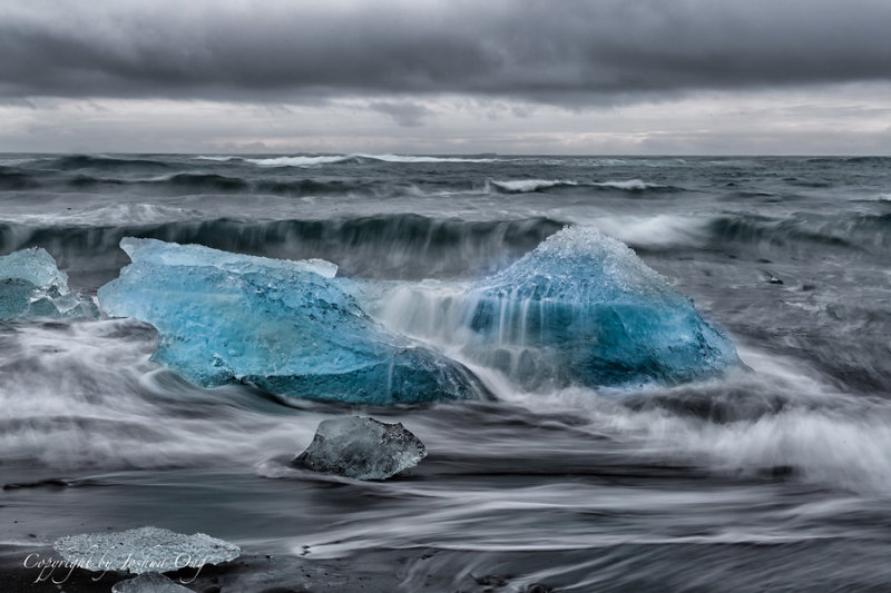 Remains of Glacial Ice - Buffeted by Waves and Wind
