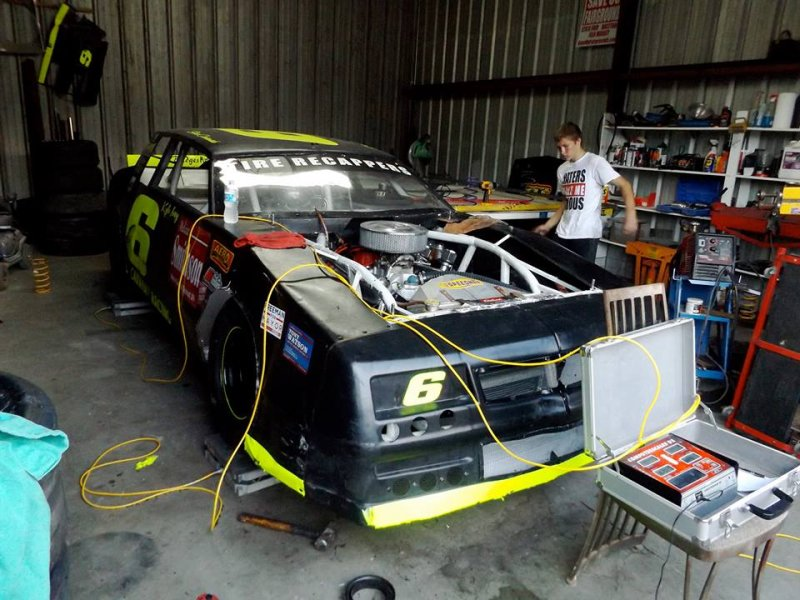 Harley Henson setting race car up on scales.