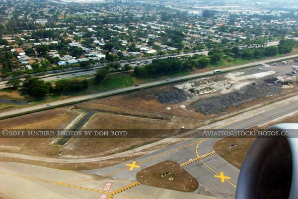 2011 - the south side of FLL and the Dania Beach residential community south of the airport aerial stock photo
