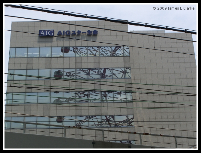 AIG Building with Wheel Reflections