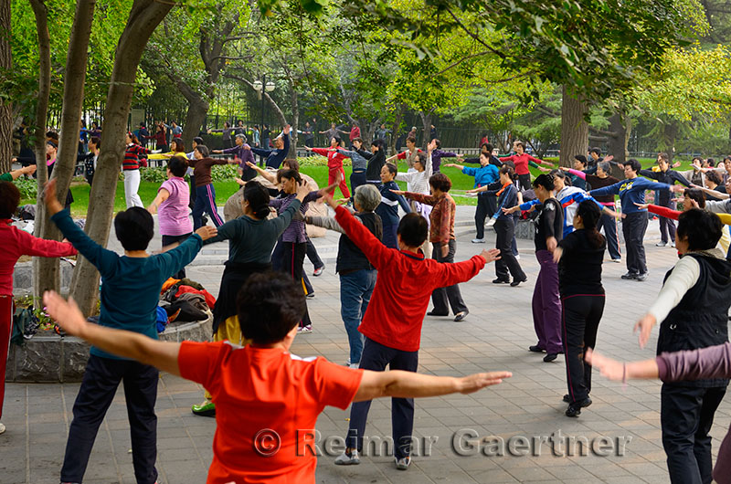 Older Chinese people at morning exercises in Zizhuyuan Purple Bamboo Park in Beijing on National holiday