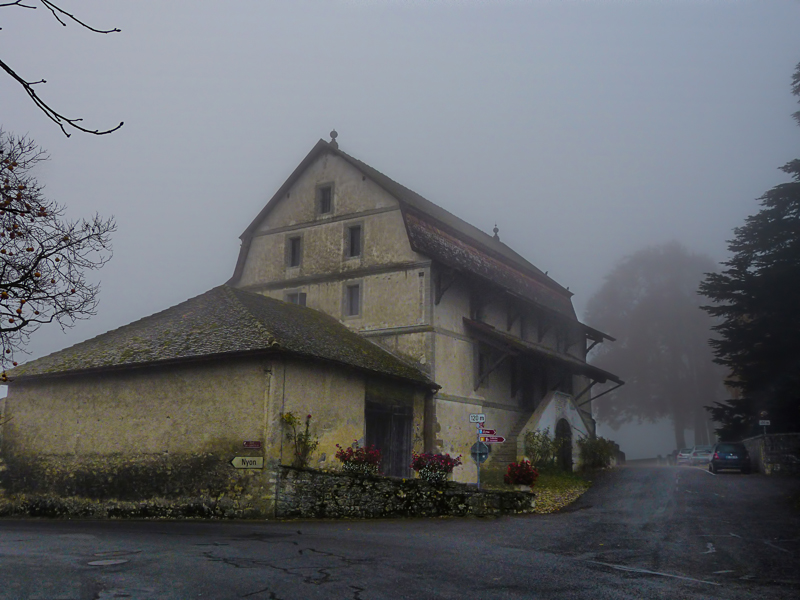 The old lonely farmhouse in the fog