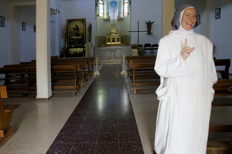 Nun caring for for the church in the convent of Palestinia Reginae