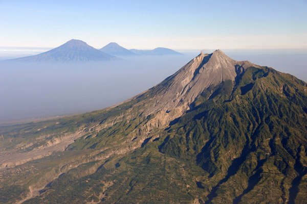 Looking west past Mt. Merapi to the central Java volcanoes of Sumbing, Sundoro and the Dieng Plateau