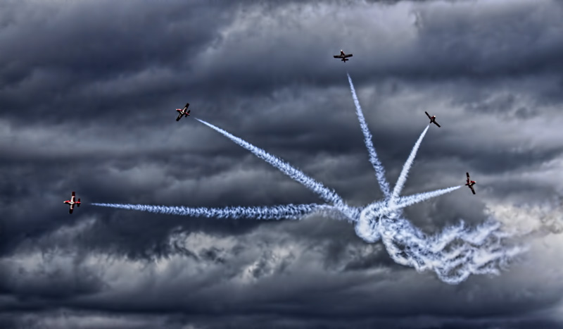 Snowbirds and Storm Clouds
