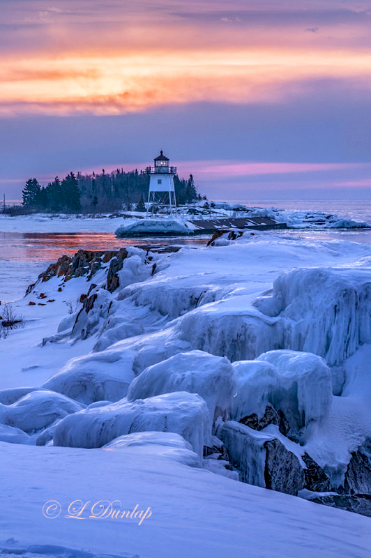 135.1 - Grand Marais Sunrise:  Harbor Light With Winter Ice