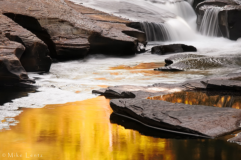 Presque Isle River golden flowing reflection