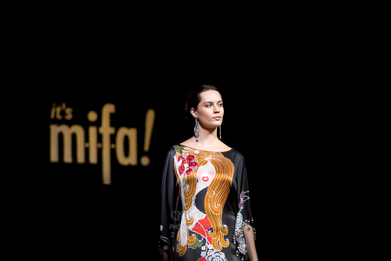 KUALA LUMPUR, MALAYSIA - NOVEMBER 28: A model wearing a printed motif dress designed by Sharifah Kirana walks on the runway at t