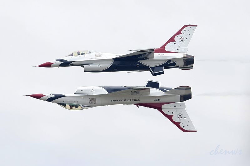 SUBANG, MALAYSIA - OCTOBER 03: Two F-16 fighter jets from the USAF Thunderbirds team perform precision flying over the TUDM airb