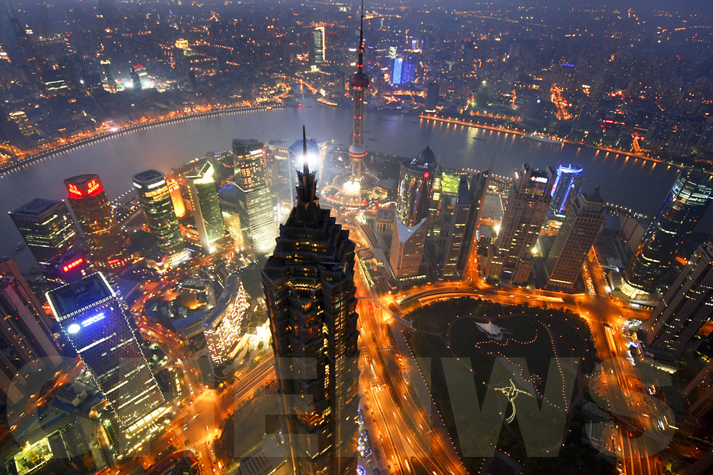 Shanghai at sunset as viewed from the Shanghai World Financial Centre Skywalk 100.