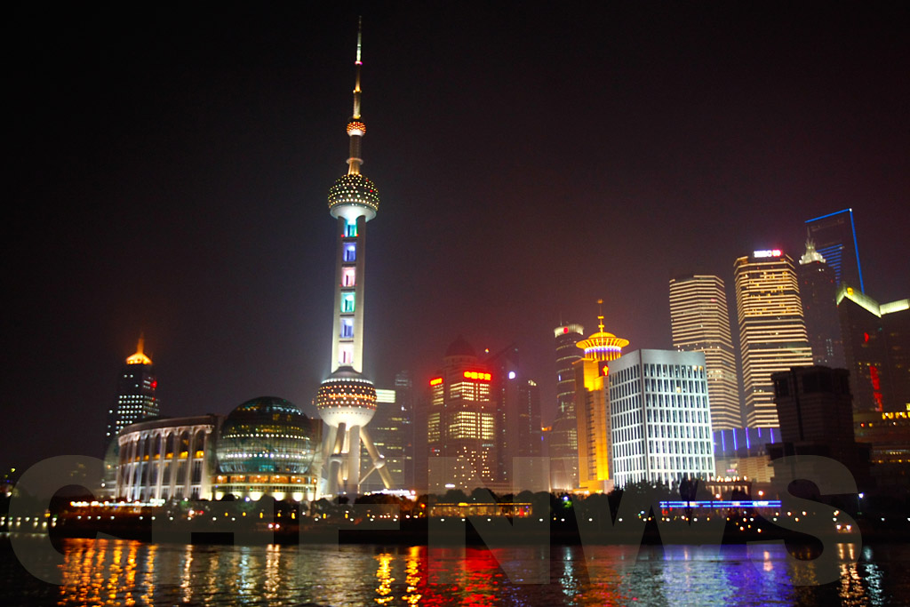 Shanghai skyscrappers and the Oriental Pearl Tower on the Huangpu River