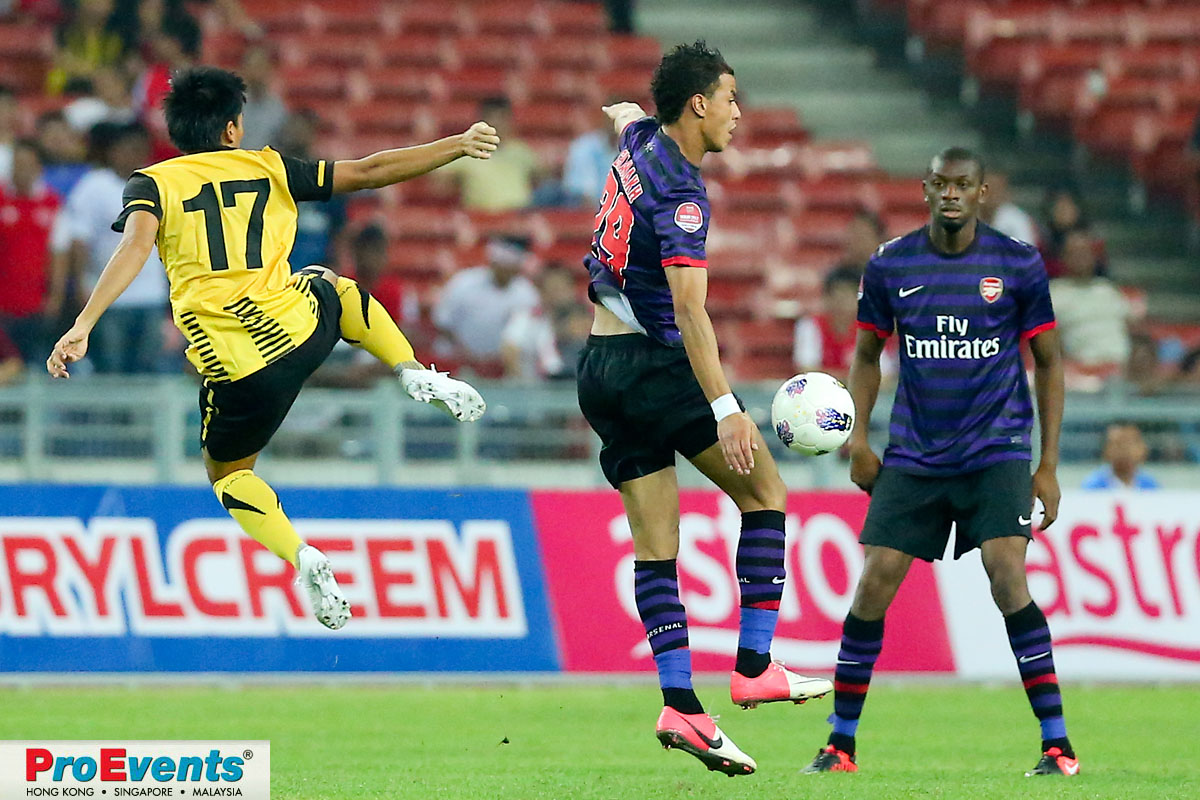 Mohd Shakir Shaari (17) clears a pass intended for M. Chamakh