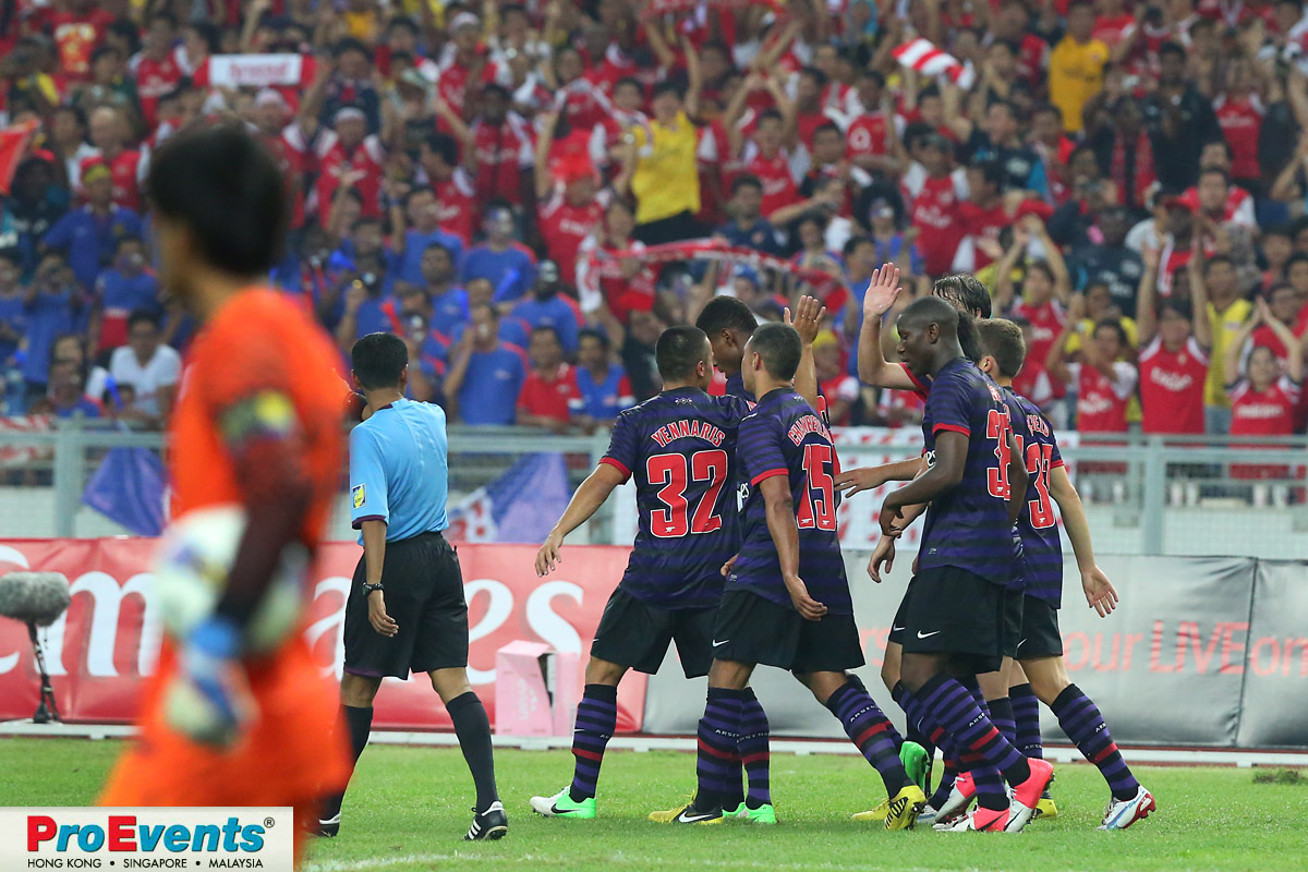 Arsenal players celebrate the second goal