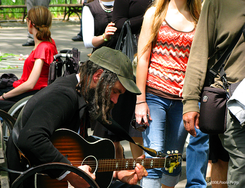 Musicians concentrated and distracted tourists
