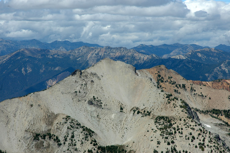 Clouds and Light Colored Scree Peak