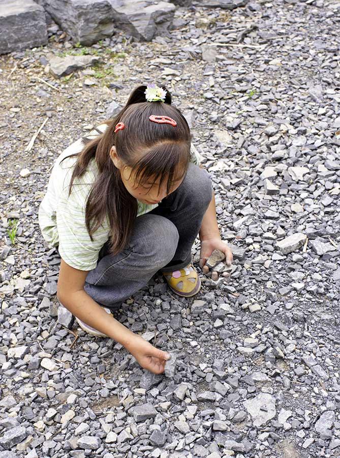 Picking rocks to make into jacks.