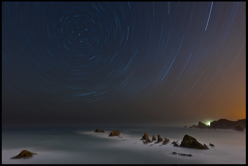 Star trails over coast of spain
