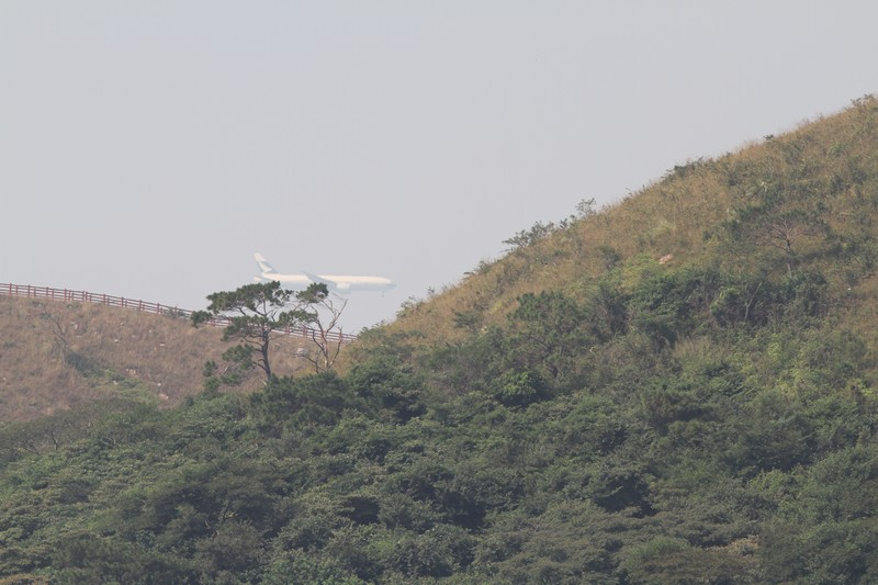 Cathay Pacific plane landing on other side of island