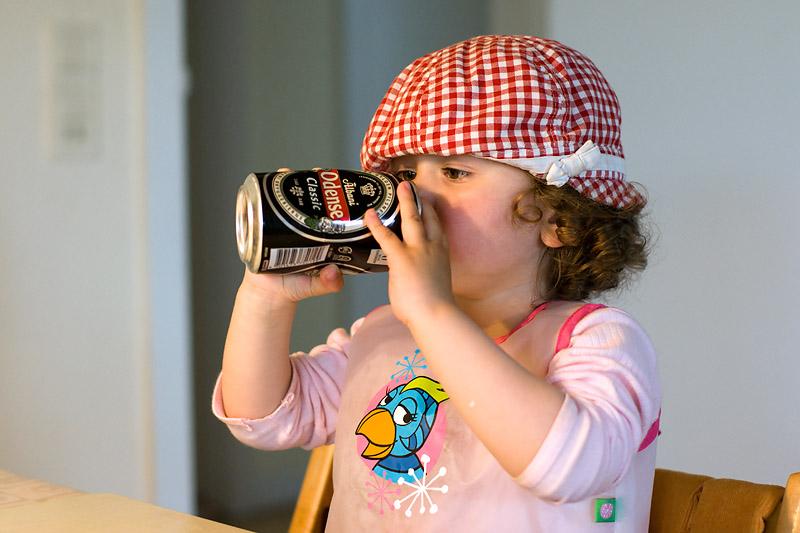 Angelica drinking beer.... well sort of