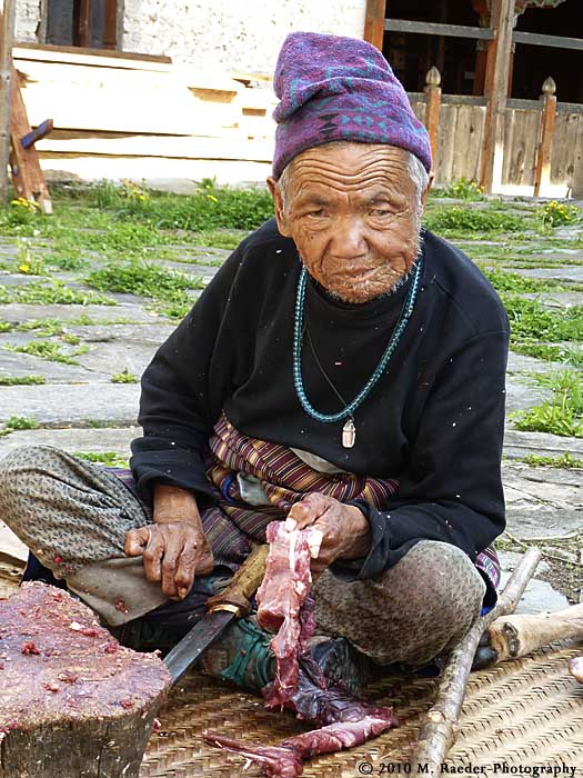 Old man producing dried meat