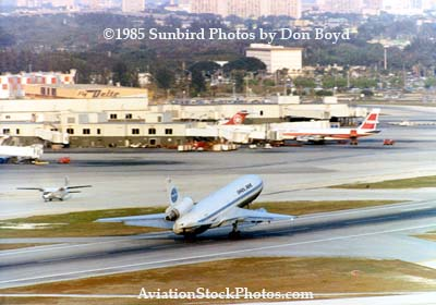 1984 or 85 - Pan Am DC-10 taking off with National Commuter, Air Canada B727 and TWA B707 parked