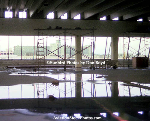 1976 - inside the north end of the E-Satellite which was under construction with water on the floor