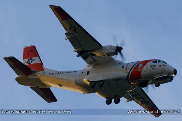 2012 - USCG CASA HC-144A Ocean Sentry #2303 on approach to Opa-locka Executive Airport military aviation stock photo
