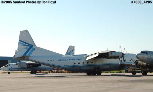 Avialeasing An-12BP UK-11418 next to damaged right wing of Florida Air Cargos DC3-S1C3G N123DZ aviation stock photo #7069