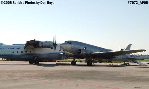 Avialeasing An-12BP UK-11418 next to damaged right wing of Florida Air Cargos DC3-S1C3G N123DZ aviation stock photo #7072