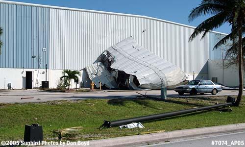 T-hangar debris blown against Miami-Dade Police aviation unit hangar by Hurricane Wilma stock photo #7074