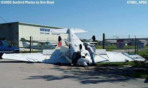 Aircraft blown over the fence by Hurricane Wilma at Opa-locka Airport stock photo #7081