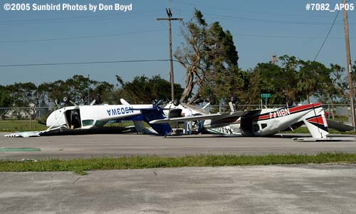 Cylinder Shop Inc.s C-172M N903WA and Wayman Aviations PA-44-180 N81144 after Hurricane Wilma stock photo #7082