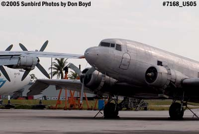 Florida Air Cargos DC3-S1C3G N123DZ and damaged right wing next to Avialeasing An-12BP UK-11418 aviation stock photo #7168