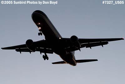 U S Airways B757 landing at dusk aviation stock photo #7327