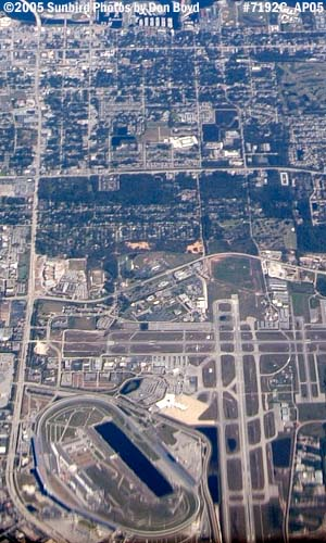 2005 - Daytona International Airport and Speedway in bottom half aerial stock photo #7192C