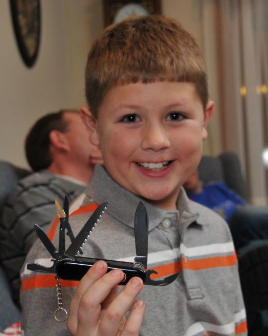 He loves his new knife ( Wenger Handyman)